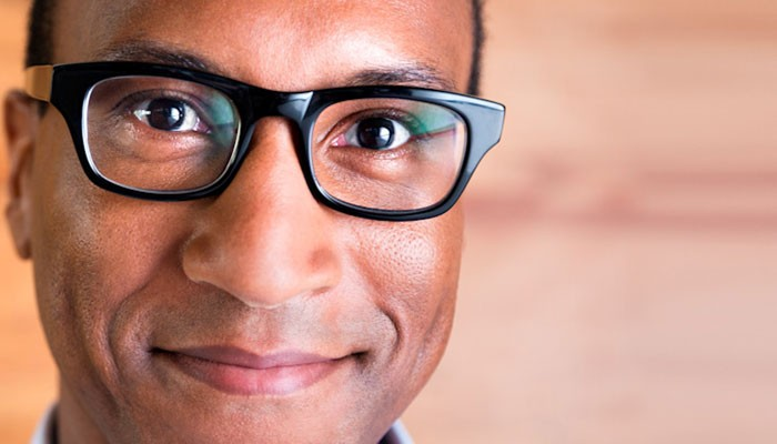 Happy African-American male with glasses
