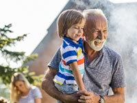 Family generations enjoying a backyard barbeque
