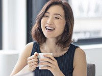 Woman drinking coffee in meeting