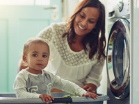 mom with kid in laundry room
